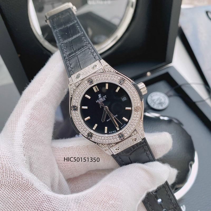 đồng hồ Hublot nữ máy cơ dây cao su bọc da màu xanh lá viền đính đá